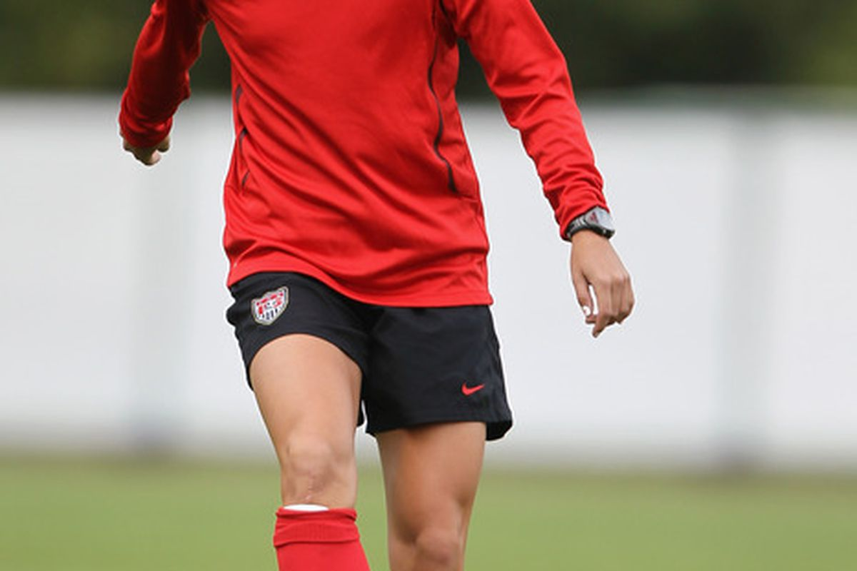 FRANKFURT AM MAIN, GERMANY - JULY 14:  Alex Morgan shoots the ball during the USA team training session at training ground Rebstock on July 14, 2011 in Frankfurt am Main, Germany.  (Photo by Christof Koepsel/Getty Images)