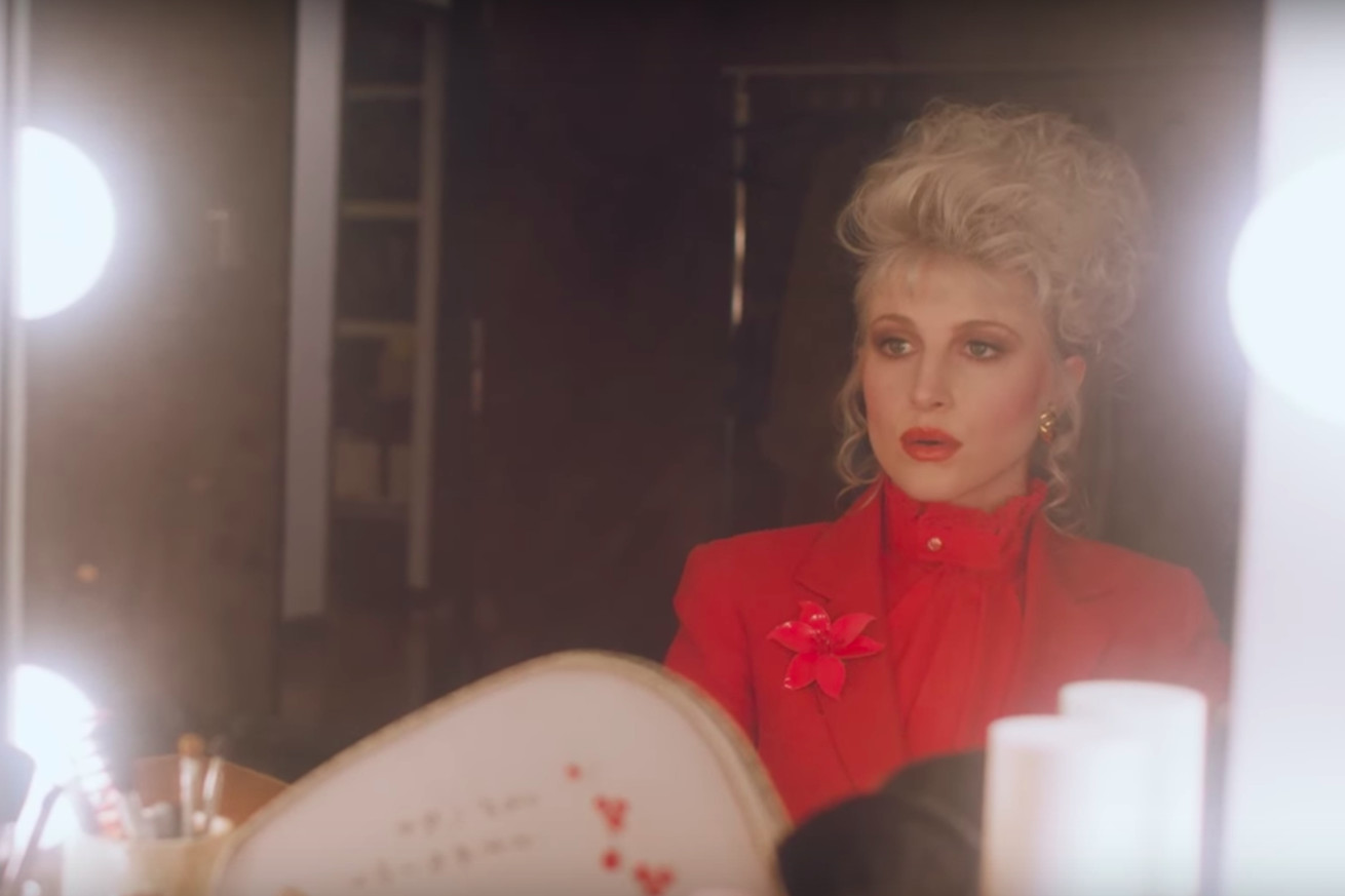 paramore stars in a demented morning show in the video for rose colored boy