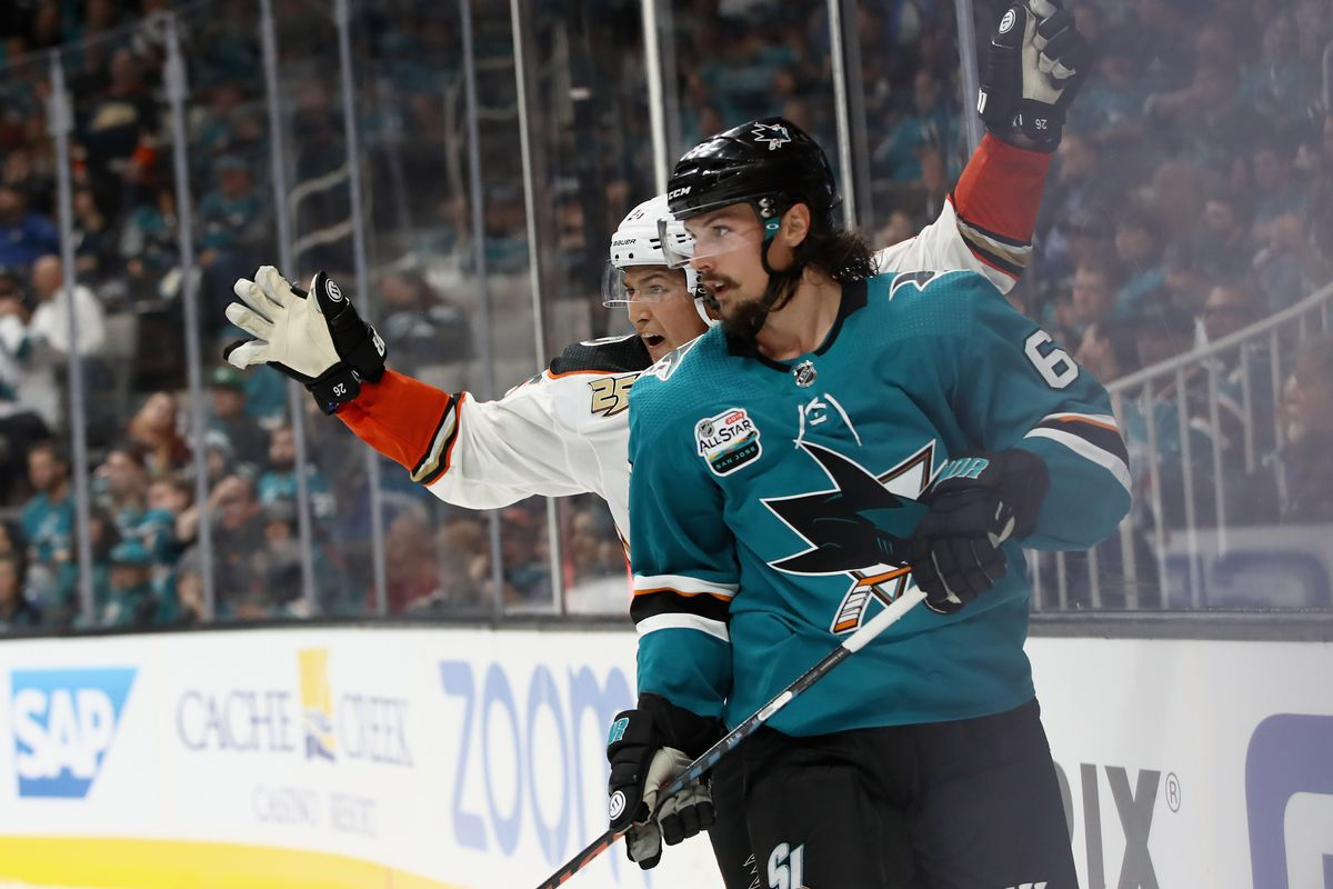 SAN JOSE, CA - OCTOBER 03: Brandon Montour #26 of the Anaheim Ducks celebrates behind Erik Karlsson #65 of the San Jose Sharks after he scored a goal at SAP Center on October 3, 2018 in San Jose, California.