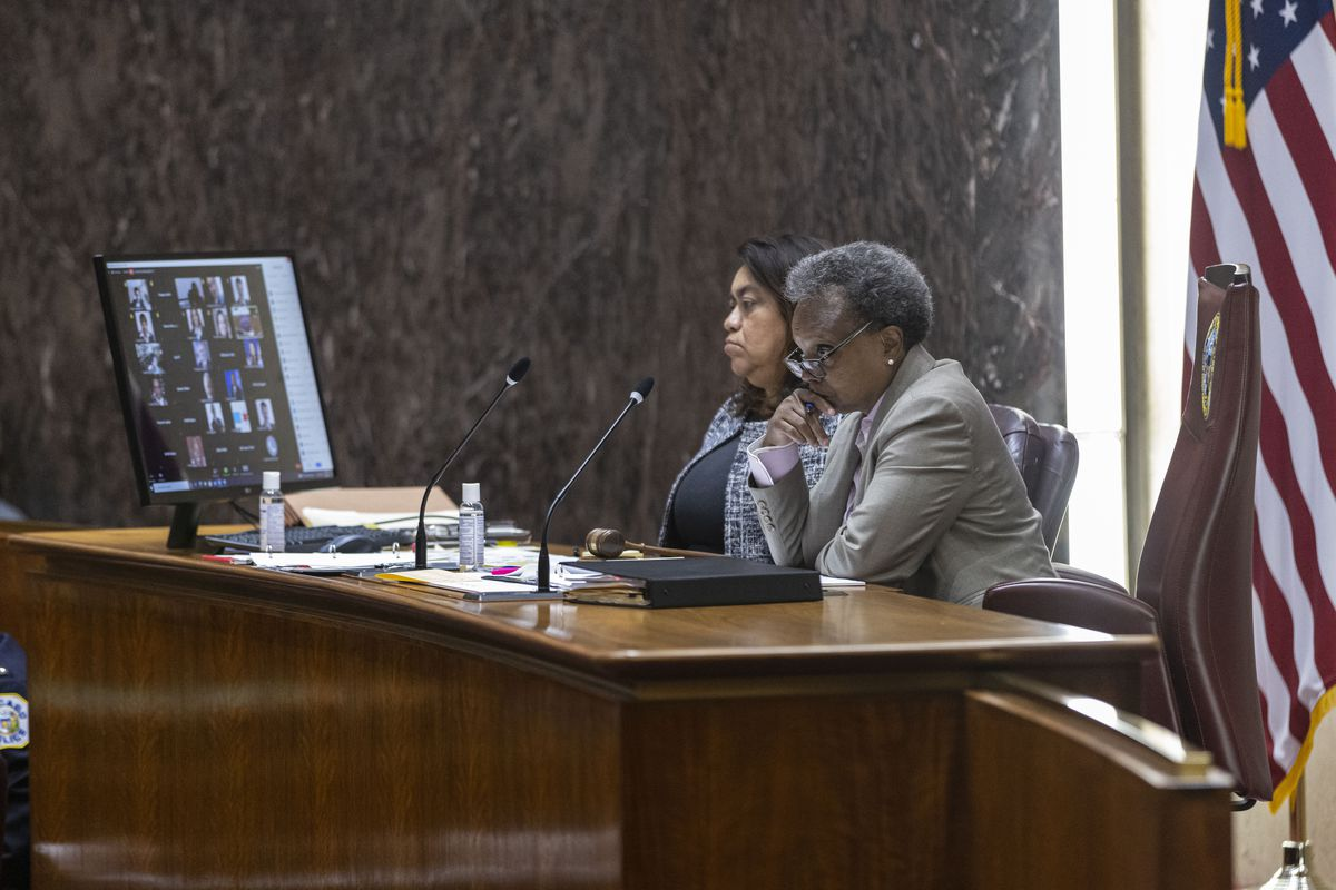 Mayor Lori Lightfoot listens to the questions during a special City Council meeting Friday.