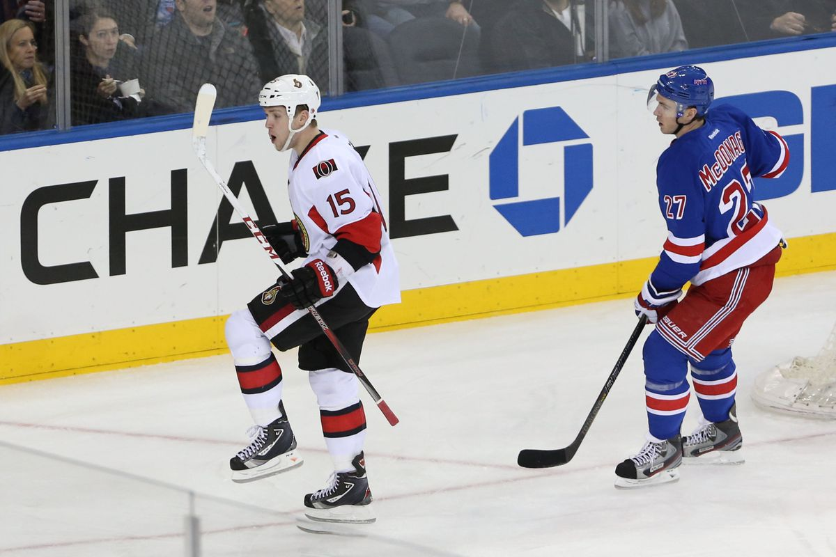 Ryan McDonagh tries not to let everyone see how impressed he is by Z. Smith's moonwalk.