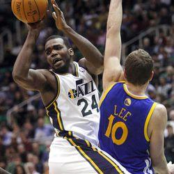 Utah Jazz forward Paul Millsap (24) passes away from the defense of Golden State's #10 David Lee as the Utah Jazz and the Golden State Warriors play Friday, April 6, 2012 in Salt Lake City. Jazz won 104-98.