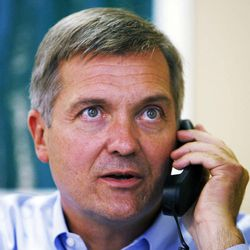 Rep. Jim Matheson talks on the phone after speaking with members of the media in West Jordan, Monday, Oct. 1, 2012.