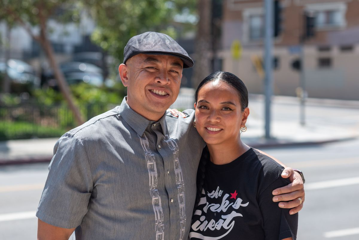 Park's Finest Barbecue owners Johneric Concordia and Christine Araquel-Concordia standing outside their restaurant.