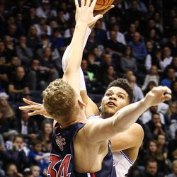 Brigham Young Cougars forward Yoeli Childs (23) takes a second-half shot over Saint Mary's Jock Landale (34) as the BYU Cougars take on the Saint Mary's Gaels in the Marriott Center in Provo on Saturday, Dec. 30, 2017.