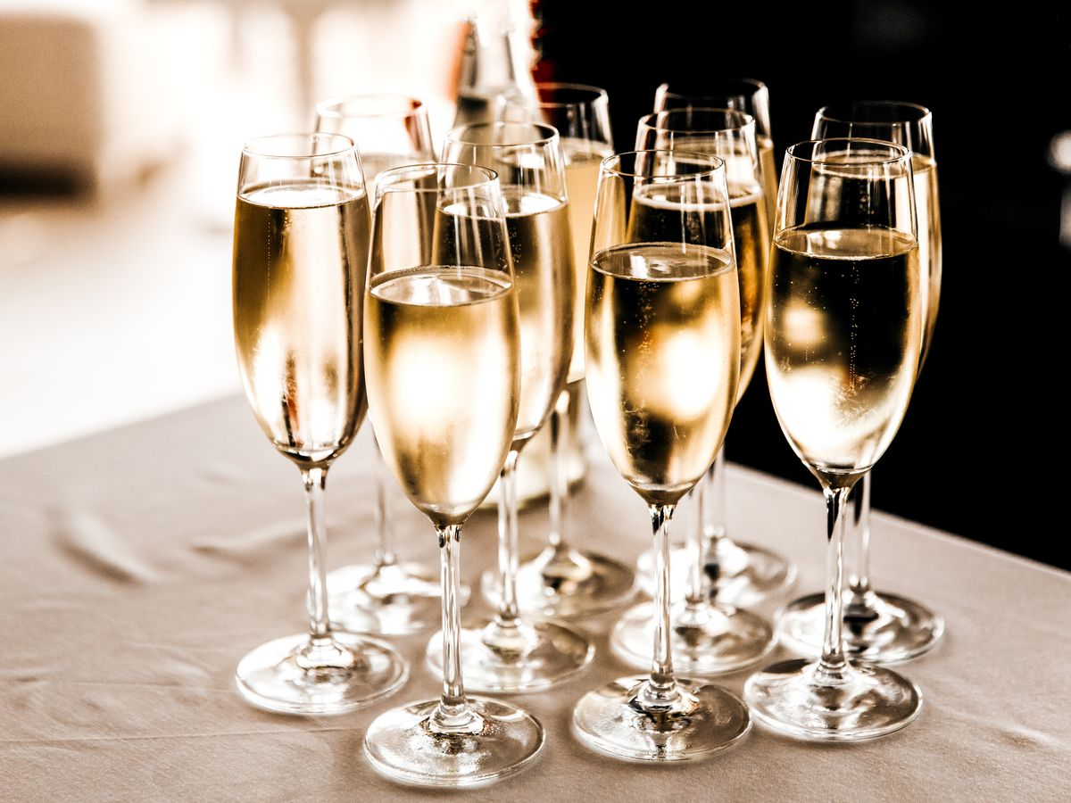 Champagne flutes filled with Champagne on a table