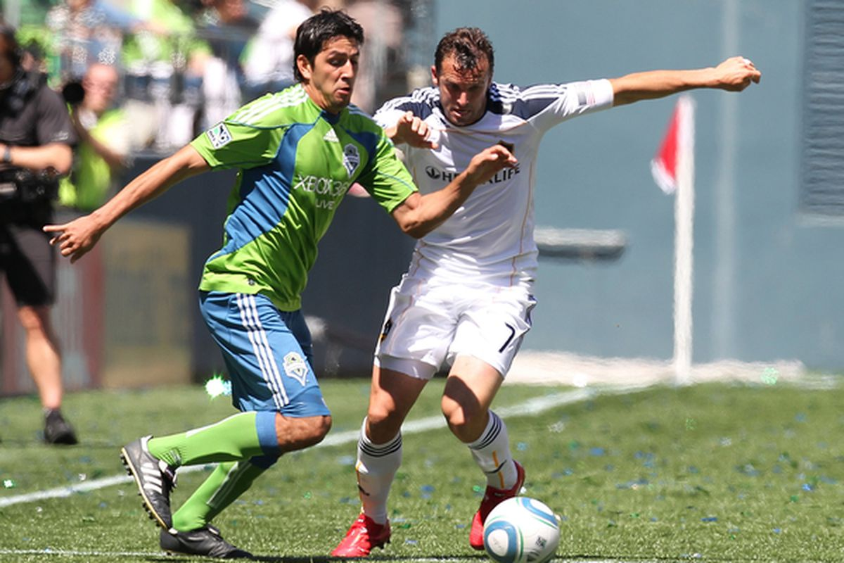 SEATTLE - MAY 08:  Leonardo Gonzalez #19 of the Seattle Sounders FC battles Chris Klein #7 of the Los Angeles Galaxy on May 8, 2010 at Qwest Field in Seattle, Washington.The Galaxy defeated the Sounders 4-0. (Photo by Otto Greule Jr/Getty Images)