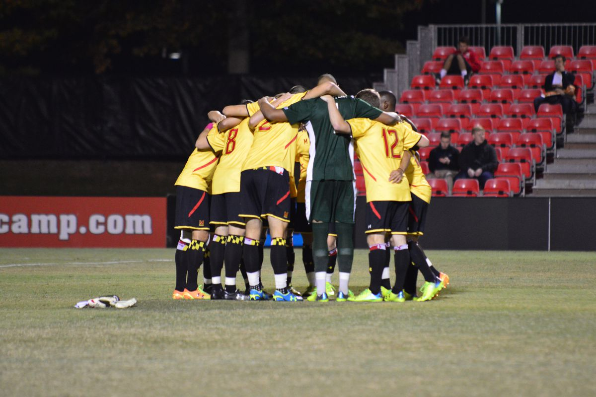 Men's soccer huddle