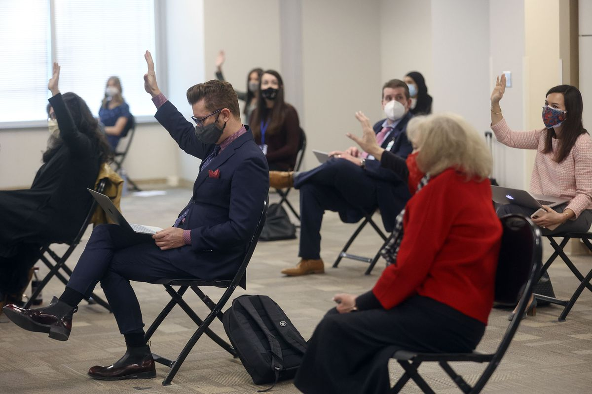 Members of the public who want to speak in opposition to HB302raise their hands during a House Education Committee meeting at the State Office Building in Salt Lake City on Thursday, Feb. 11, 2021.The bill would bar transgender athletes at public schools to participate in girls sports.