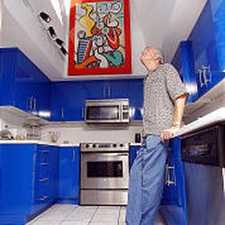 Hot Rod Hundley looks through the skylight in the kitchen of his home in Holladay.