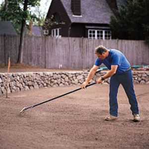 Roger Cook Surfacing Dirt Surface With Rake