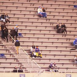 A few fans take their seats in the upper bowl as BYU and Boise State prepare to play a college football game at Albertsons Stadium in Boise on Friday, Nov. 6, 2020.