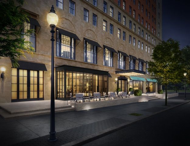Rendering of the first few floors of a hotel at nighttime as it meets the city sidewalk.