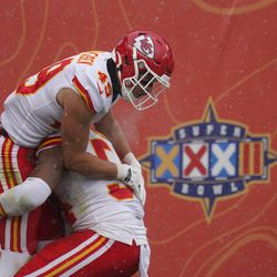 Kansas City Chiefs free safety Daniel Sorensen reacts with outside linebacker Damien Wilson after running an interception back for a touchdown during the first half of an NFL football game against the Denver Broncos, Sunday, Oct. 25, 2020, in Denver.