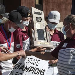 Members of the Morgan High School golf team hold up their first-place trophy during the 3A boys stat golf championship at Round Valley Golf Course in Morgan on Thursday, Oct. 8, 2020.
