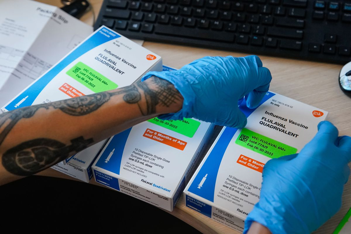 Nurse Kimberly Goldberg puts labels on boxes with influenza vaccine at the Salt Lake Public Health Center on Thursday, Sept. 30, 2021.