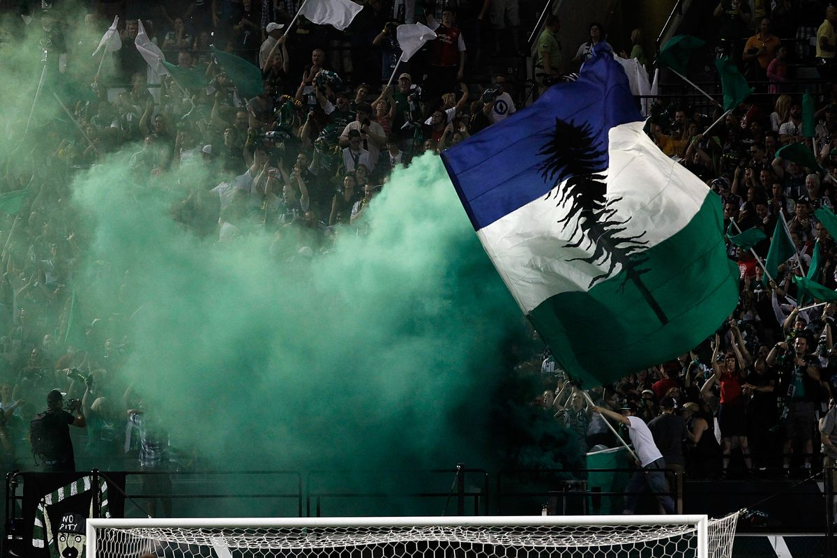 PORTLAND, OR - AUGUST 25: Fans of the Portland Timbers celebrate a goal against the Vancouver Whitecaps on August 25, 2012 at Jeld-Wen Field in Portland, Oregon. (Photo by Jonathan Ferrey/Getty Images)