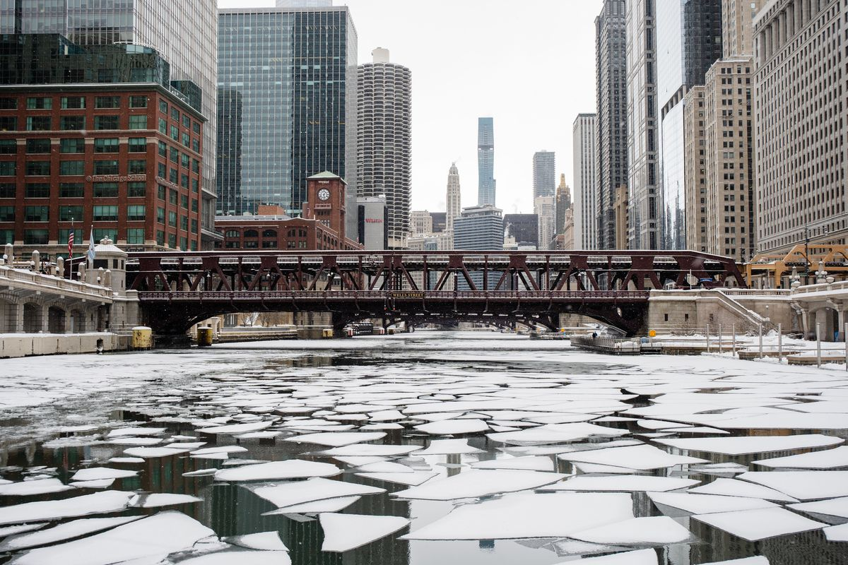 """The Chicago Fire Department's engine, """"Christopher Wheatley,"""" breaks ice Thursday afternoon on the Chicago River in the Loop."""