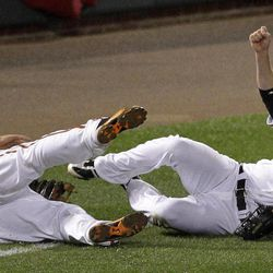 Baltimore Orioles third baseman Mark Reynolds, left, and left fielder Nolan Reimold slide as they miss a fly ball by New York Yankees' Mark Teixeira in the 10th inning of a baseball game in Baltimore, Wednesday, April 11, 2012. New York won 6-4 in 10 innings.