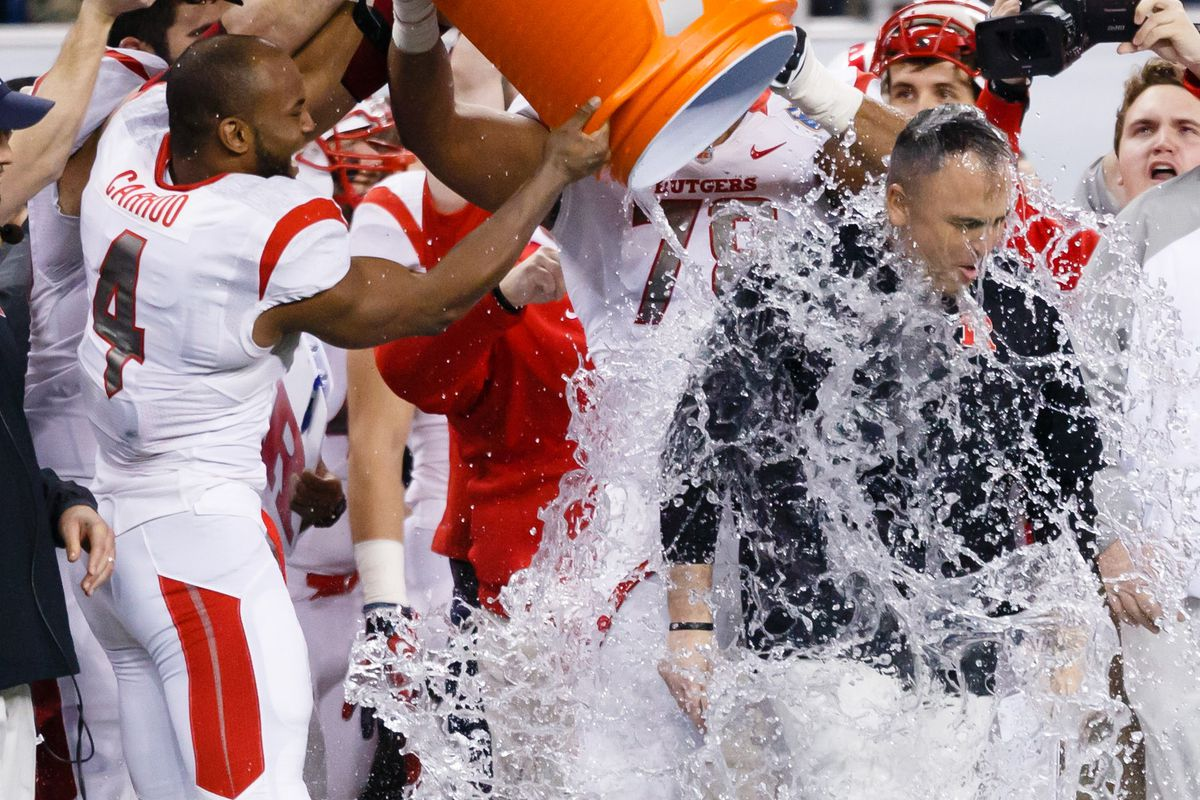 Rutgers players douse Kyle Flood after a victory in the 2014 Quick Lane Bowl