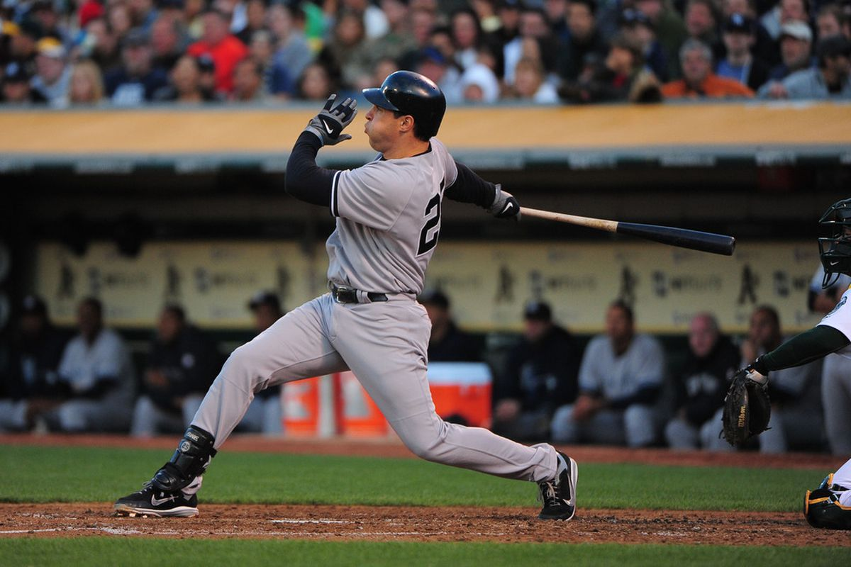 May 25, 2012; Oakland, CA, USA; New York Yankees first baseman Mark Teixeira (25) hits a two-run home run during the third inning against the Oakland Athletics at O.co Coliseum. Mandatory Credit: Kyle Terada-US PRESSWIRE