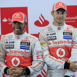 McLaren Formula One driver's Lewis Hamilton, left, and Jenson Button of Britain smile at a sponsors function at the Chinese Formula One Grand Prix in Shanghai, China, Thursday, April 12, 2012.