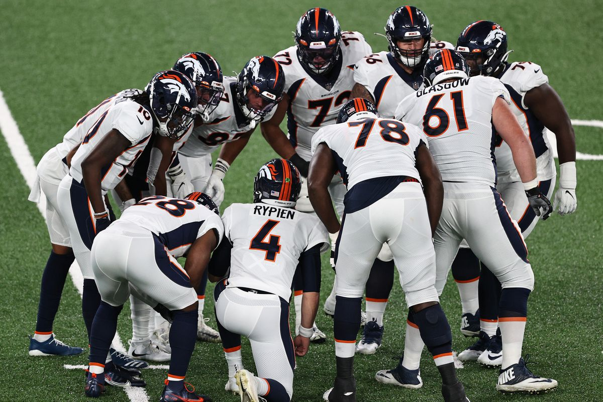 Brett Rypien #4 of the Denver Broncos huddles the offense against the New York Jets during the first quarter at MetLife Stadium on October 01, 2020 in East Rutherford, New Jersey.