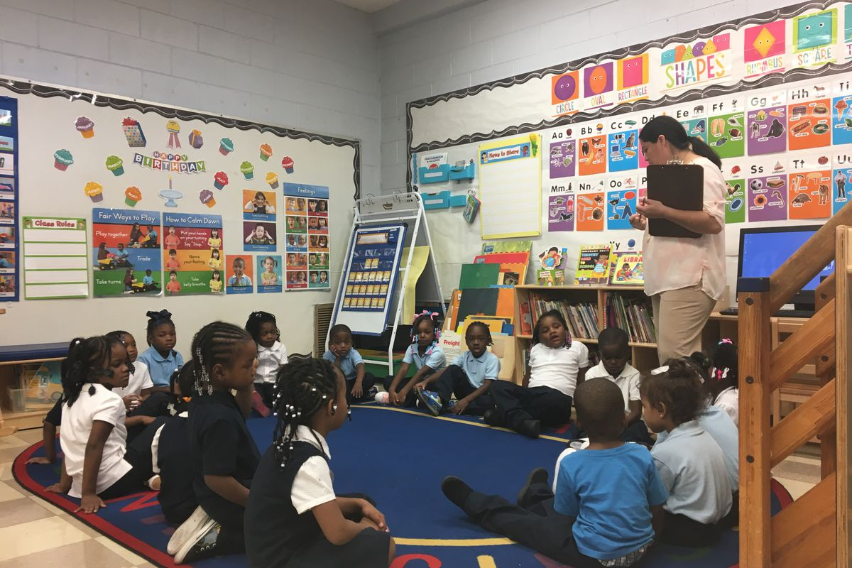 Brownell Elementary teacher Jane Godina addresses her pre-K class Wednesday, Sept. 5, 2018, the second day of school in Chicago.