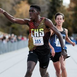 Cedar High's Bailey Oswald edges out Stansbury's Josh Oblad to take second place in the 4A Boys State Cross-Country Championships at Highland High School in Salt Lake City on Wednesday, Oct. 23, 2019.