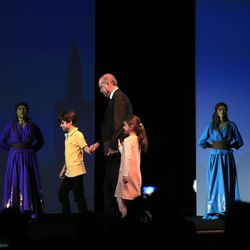 Children accompany Turkey's President Recep Tayyip Erdogan as he walks to deliver a speech at the opening ceremony of the World Humanitarian Summit, in Istanbul, Monday, May 23, 2016. World leaders and representatives of humanitarian organisations from across the globe converge in Istanbul on May 23-24, 2016 for the first World Humanitarian Summit, focused on how to reform a system many judge broken.