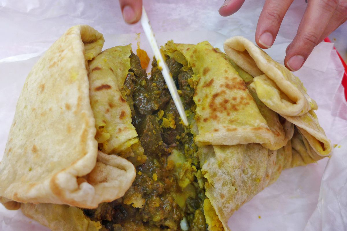 Goat roti in the wrap formation