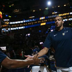 Utah Jazz center Rudy Gobert (27) takes to the court before the game against the Golden State Warriors at Vivint Arena in Salt Lake City on Tuesday, April 10, 2018.