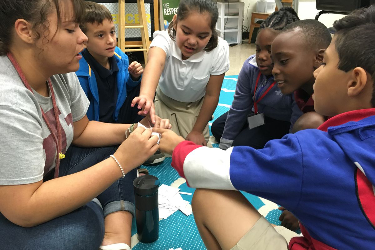 Third-grade students work in a small group with a student teacher to practice multiplication at Indianapolis Public Schools' Lew Wallace School 107 on Oct. 3, 2018.