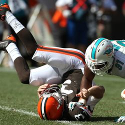 Sep 8, 2013; Cleveland, OH, USA; Miami Dolphins defensive end Cameron Wake (91) sacks Cleveland Browns quarterback Brandon Weeden (3) during the fourth quarter at FirstEnergy Field. The Dolphins won 23-10.