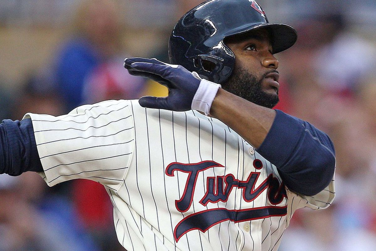 May 26, 2012; Minneapolis, MN, USA: Minnesota Twins center fielder Denard Span (2) hits a home run in the sixth inning against the Detroit Tigers at Target Field. Mandatory Credit: Jesse Johnson-US PRESSWIRE