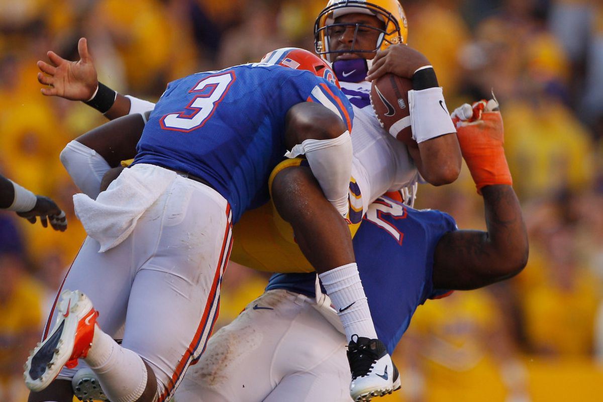 BATON ROUGE, LA - OCTOBER 08:  Jordan Jefferson #9 of the Louisiana State University Tigers is tackled by Jelani Jenkins #3 of the Florida Gators at Tiger Stadium on October 8, 2011 in Baton Rouge, Louisiana.  (Photo by Chris Graythen/Getty Images)