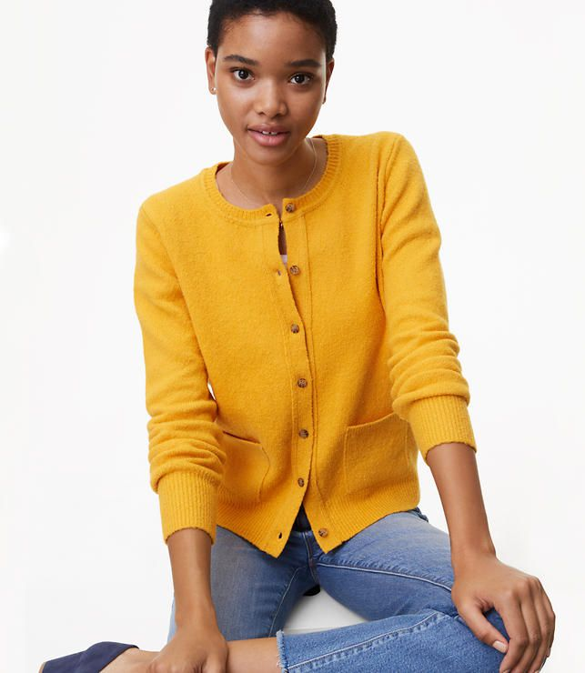 39918e276 A model in a yellow cardigan and jeans