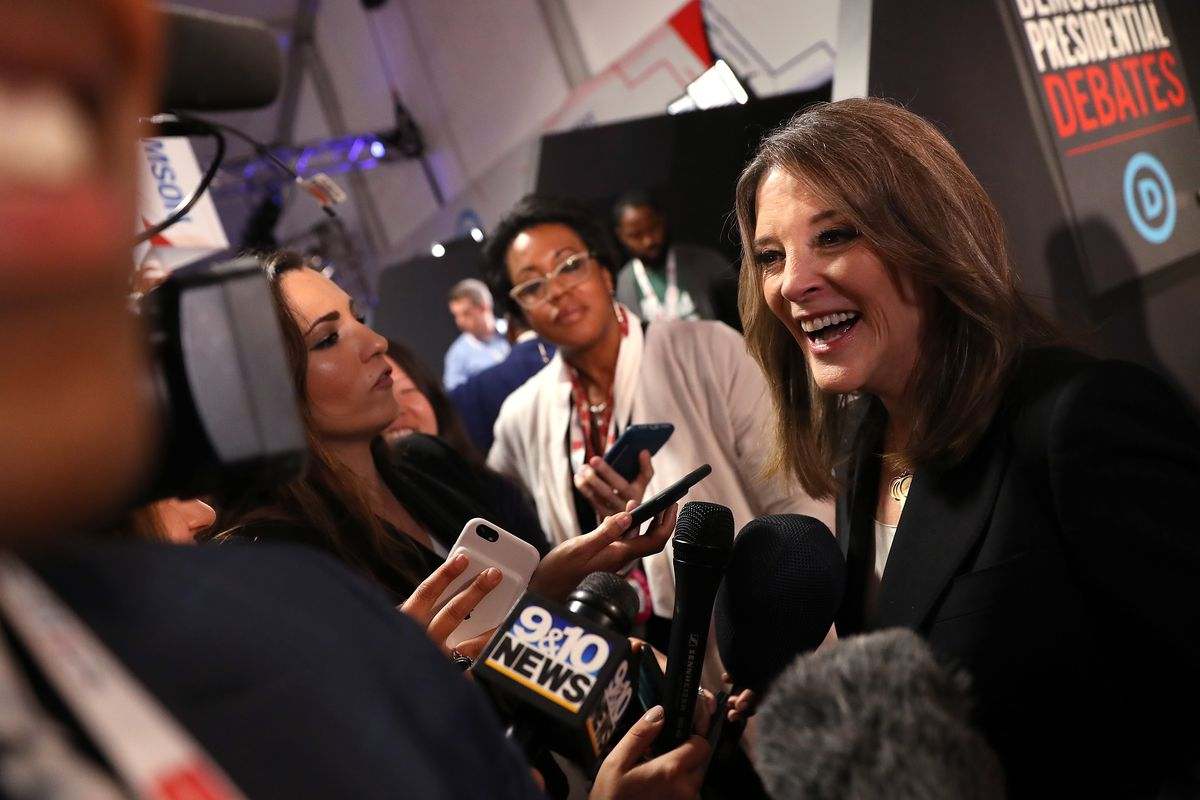 Marianne Williamson talking to the media after the July debate.