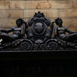 A detail of the carvings on a book case from the 1600s that used to belong to the Medici family of Italy is displayed at Euro Treasures Antiques in Salt Lake City on Thursday, June 8, 2017.