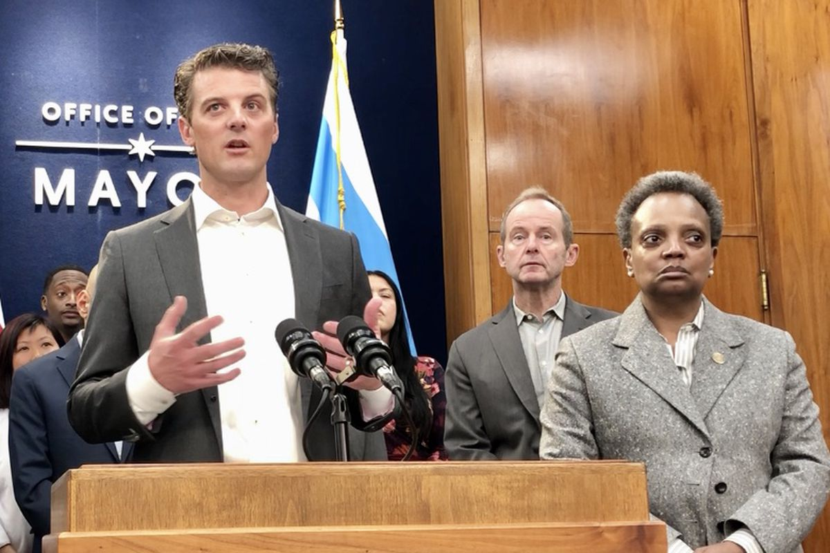 Grubhub CEO Matt Maloney at a City Hall news conference Friday with Mayor Lori Lightfoot by his side and restaurateurs and 44th Ward Ald. Tom Tunney in the background.