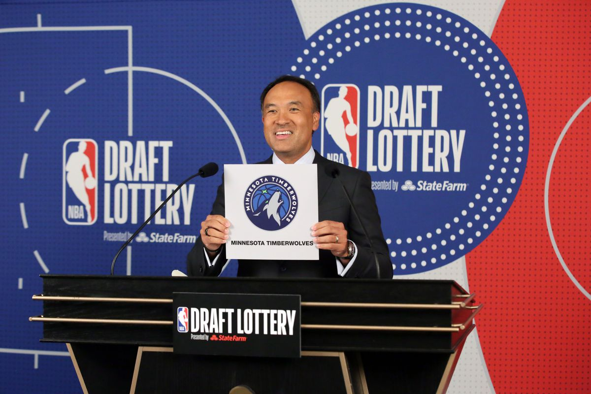 Deputy Commissioner of the NBA, Mark Tatum holds up the card of the Minnesota Timberwolves after they get the 1st overall pick in the NBA Draft during the 2020 NBA Draft Lottery on August 20, 2020 at the NBA Entertainment Studios in Secaucus, New Jersey.
