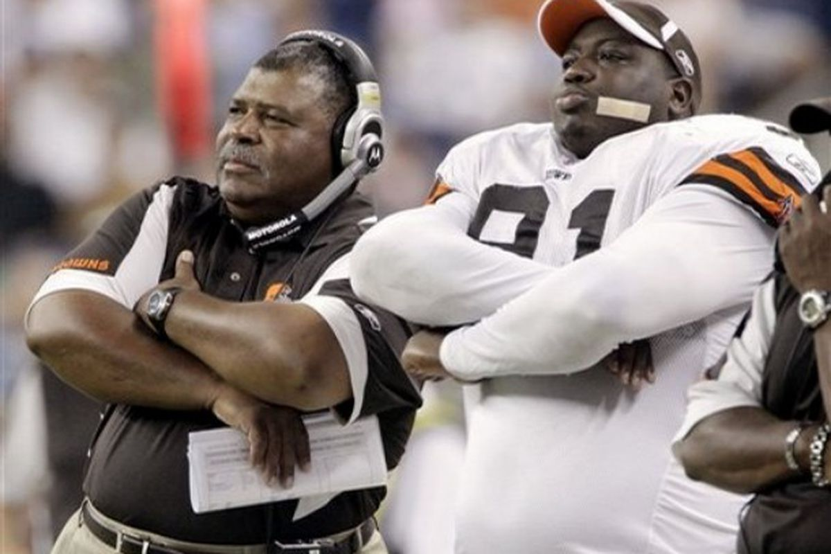 AP Photo: Cleveland Browns coach Romeo Crennel, left, and defensive lineman Shaun Smith watch from the sideline during the fourth quarter of their 26-6 loss to the Detroit Lions in an NFL preseason football game Saturday, Aug. 23, 2008, in Detroit.