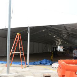 1:16 p.m. The VIP/Players' parking tent being reinstalled -