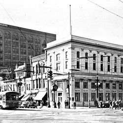 Salt Lake City's famous clock stands on the corner of Main Street and 100 South in this 1930s photograph.