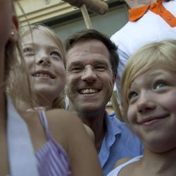 Dutch Prime Minister Mark Rutte poses with children during a campaign visit four days ahead of the national elections, in Dordrecht, south-western Netherlands, Saturday, Sept. 8, 2012. With the debt crisis plunging the European Union into the darkest days of its history,  many commentators are wondering whether Wednesday's Dutch elections will radically transform their relationship with the EU,  one of the nations that forged unity from the ashes of World War II.