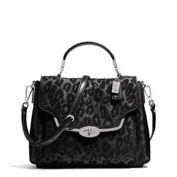 """<a href=""""http://f.curbed.cc/f/Coach_111913_Satchel"""">Madison Small Sadie Flap Satchel in Chenille Ocelot</a>, $278"""