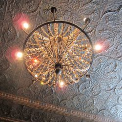 Finishing touches like chandeliers were added to give the space more character.