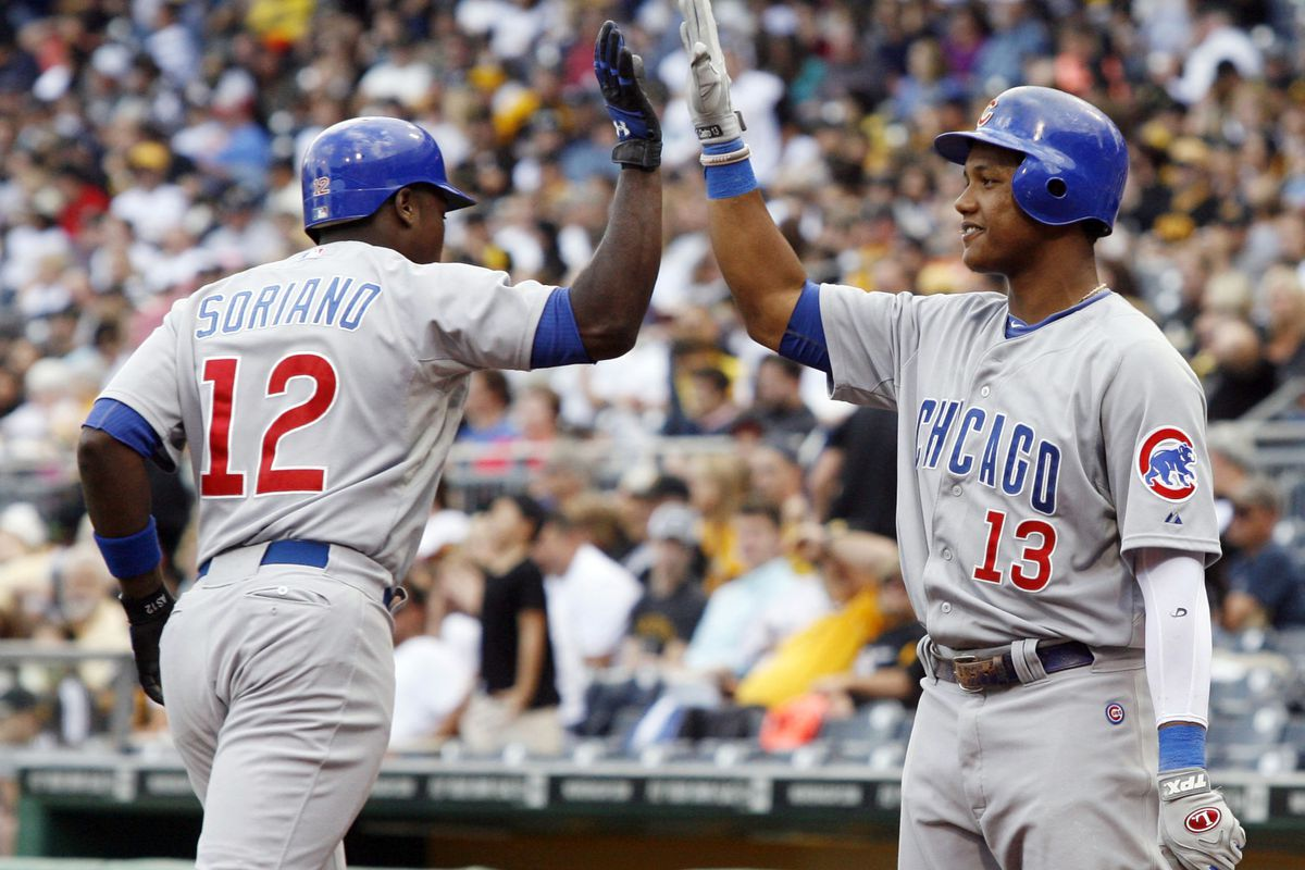 Pittsburgh, PA, USA; Chicago Cubs left fielder Alfonso Soriano is congratulated by Cubs shortstop Starlin Castro after Soriano hit a two-run home run against the Pittsburgh Pirates at PNC Park. Credit: Charles LeClaire-US PRESSWIRE