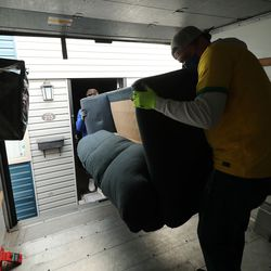 Elders Tanner Tripp and Walker Lima from The Church of Jesus Christ of Latter-day Saints help Douglas and Pam Henderson move their belongings after being evicted from their apartment in South Salt Lake on Tuesday, Jan. 12, 2021.