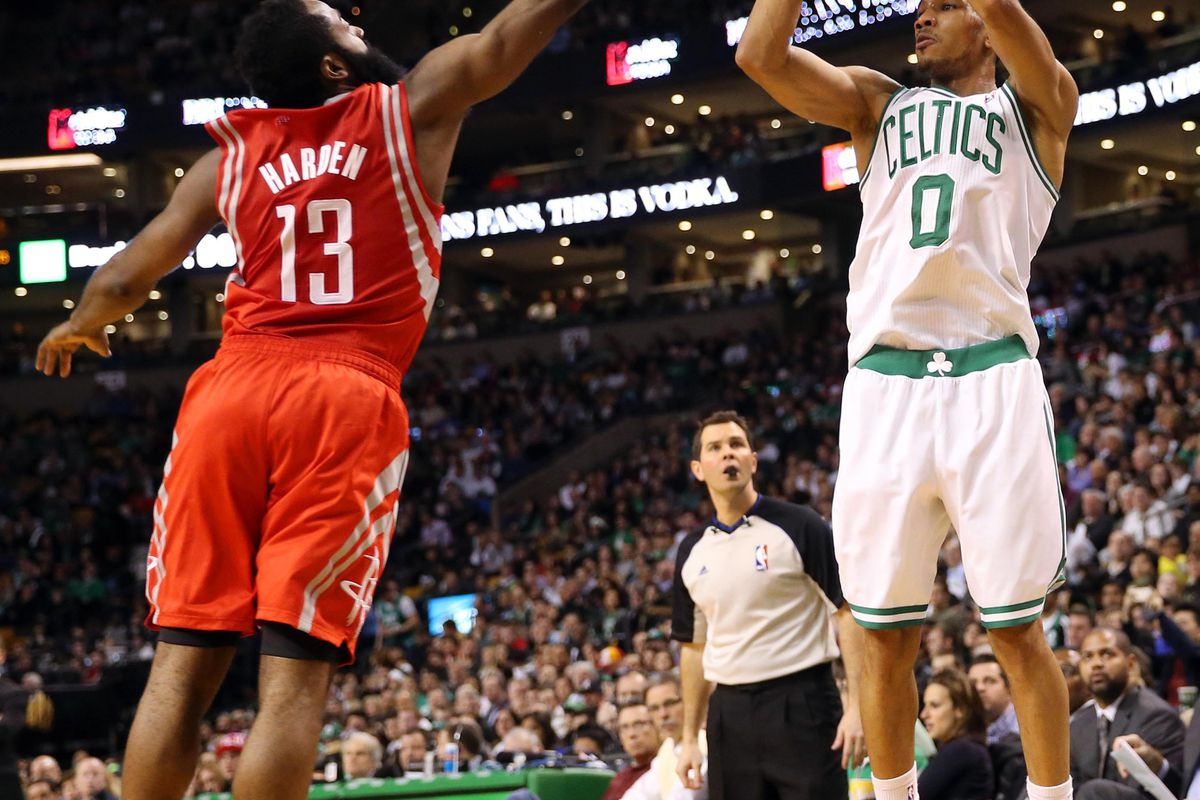 Avery Bradley tries to shoot over James Harden